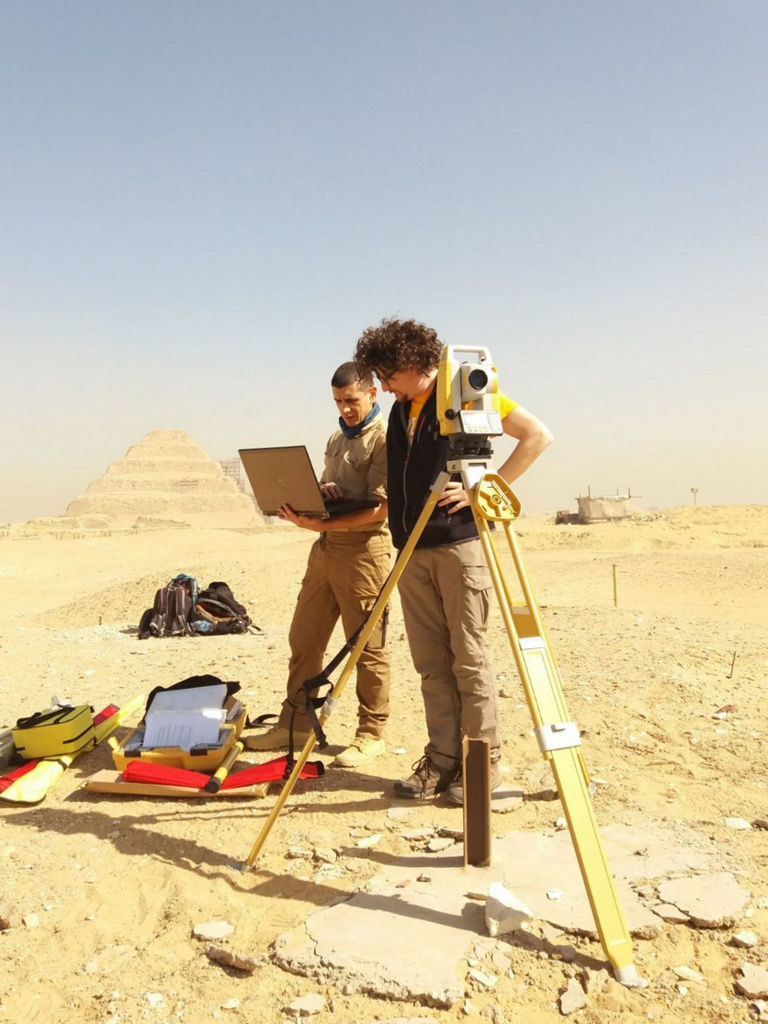 Francesco Fassi and Alessandro Mandelli of the 3D Survey Group checking the reference grid of the excavation area. Photo by Leiden-Turin Expedition to Saqqara.